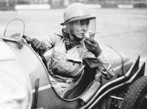 Doreen Evans in MG (Q or R Type?) . Photo making pit stop at Brooklands BRDC 500 1935